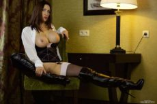 Miss Hybrid stunning in stockings and suspendes with leather thigh boots.
