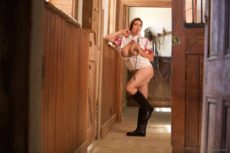 Miss Hybrid sexy bare legs and riding boots in the stables.